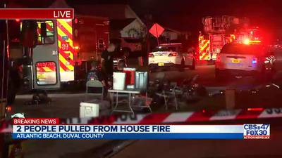 2 people pulled from house fire