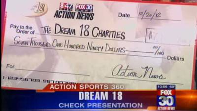 Dream 18 hands out big check to charity
